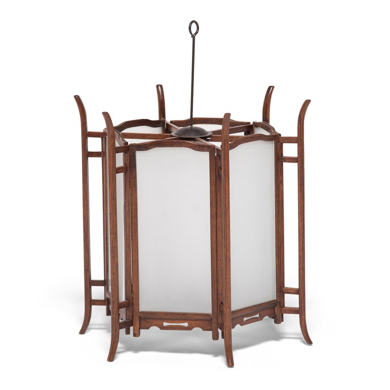 Elegantly constructed of thin pieces of rosewood, this pair of ornate 19th century lanterns would have originally been lit with candles to illuminate a very fine courtyard home in China's Shanxi province. Chinese lanterns have a history that goes