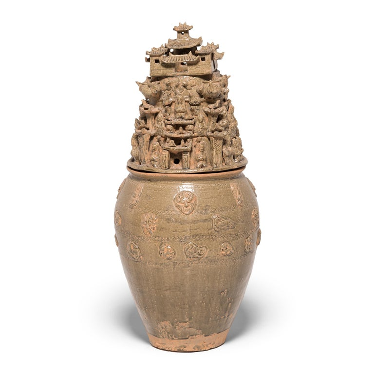 Handcrafted in China's Jiangxi province in the early 19th century, these tall ceramic vessels were shaped with exquisite detail in the spirit of ancient temple jars. The style and neutral glazing of these two urns are reminiscent of Han-dynasty