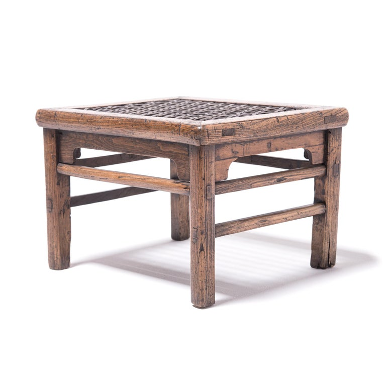 The top of this stool was woven with incredible care by a skilled artisan who used thin strips of hide to create multiple patterns in the seat, including stars. The hand-hewn stool with exposed joinery was made in northern China over 150 years ago