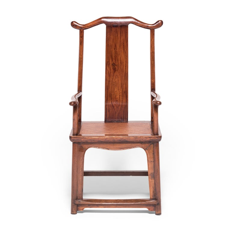 This pair of tallback chairs is a beautiful example of traditional Qing-dynasty forms. Known as official's hat armchairs, these chairs are named for the protruding ends of their top rails and arms, which bear resemblance to the hats worn by
