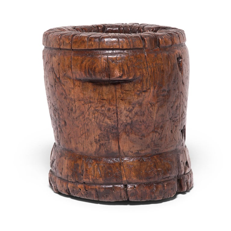 This 19th century sculptural container was originally used as a mortar, possibly in a Chinese apothecary to grind herbal medicines. Marked by petite butterfly joints and textured by the natural knots and crevices of northern elmwood, this wooden