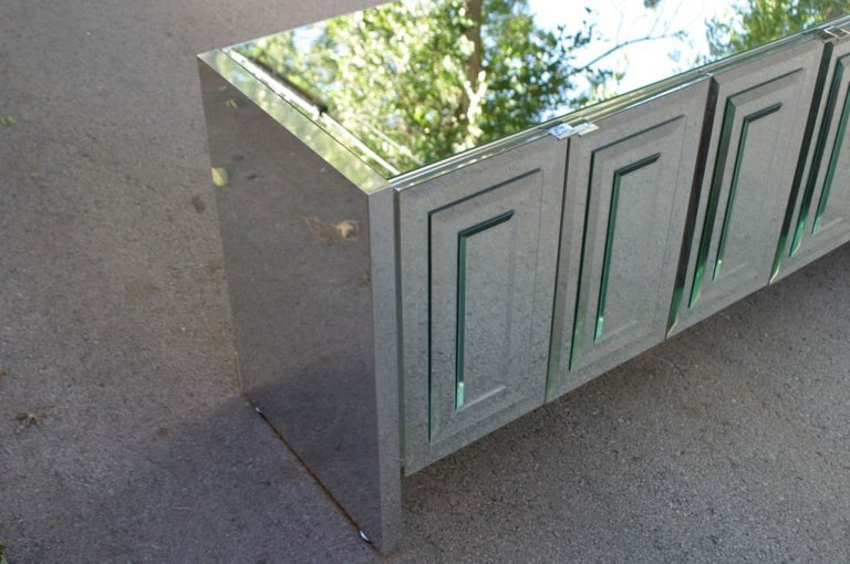 Hollywood Regency Ello mirrored doors and top credenza with concentric beveled glass rectangles on doors with chrome pulls, Chrome clad sides. I also have two 5 ft version available. Nice Condition.