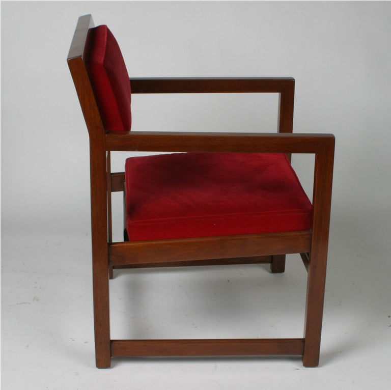 Edward Wormley for Dunbar Model number 842, set of eight armchairs in mahogany with red velvet seats. All original, minor touch up prior to shipping. These chairs were used around a large custom dining table in the school of Frank Lloyd Wright by