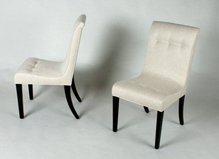 Edward Wormley for Dunbar set of four elegant side chairs with dark mahogany legs. Current set of four, have original leather seats, need to be reupholstered. Price includes refinishing of legs only.  Dunbar model #3228B.