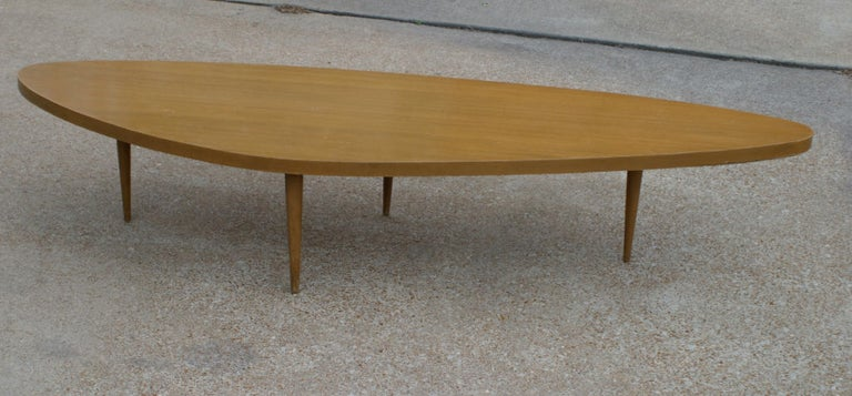 Harvey Probber Mid-Century Modern biomorphic coffee table with tapered legs in the style of George Nakashima for Widdicomb Sundra. Price includes refinishing to specification (can be stained any color).
