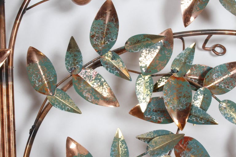 Tree of life wall sculpture in copper toned metal with verdigris highlights on leaves, signed C. Jere and dated 1977. In very nice condition, bright and fresh. This can ship UPS for less than white glove, please inquire for a quote.