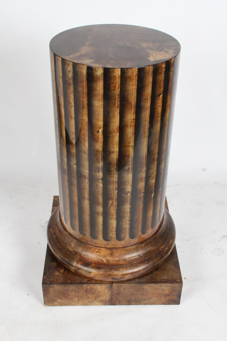 Aldo Tura goatskin architectural column form dry bar with tromper l'oeil painted flutes, made in Italy. The bars interior is luxuries, with zebra wood lined door, gold plated hardware, full glass lower shelf and two crescent shaped upper shelves,