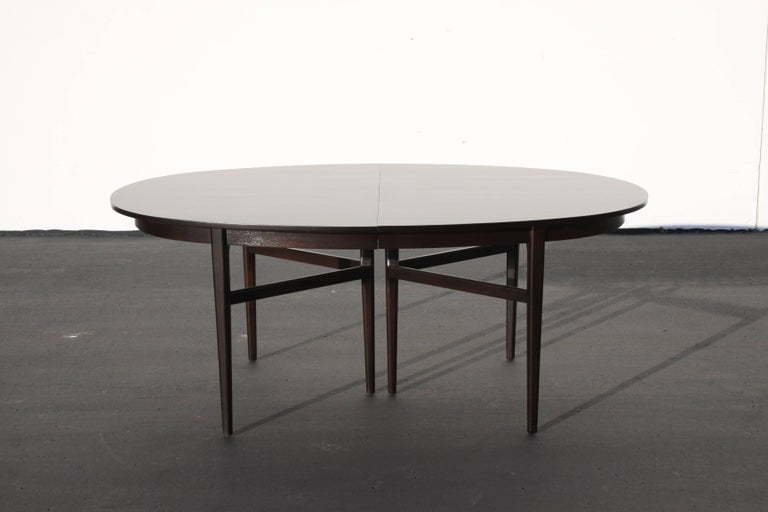 """Mid-century oval dining table by Rom Weber, with two 12"""" extension leaves. Table can accommodate a third leaf, an exact match can be made for $300. Refinished in dark espresso.  In the style of Hans Wegner or Danish modern.   8' foot with two"""