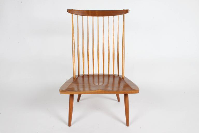 George Nakashima New Lounge Chair - Studio production c. 1978 for St. Louis Architect Phillip Cotton in beautiful walnut with great patina. This chair comes with the original documents and receipt from the Nakashima Studio. Bottom of chairs is