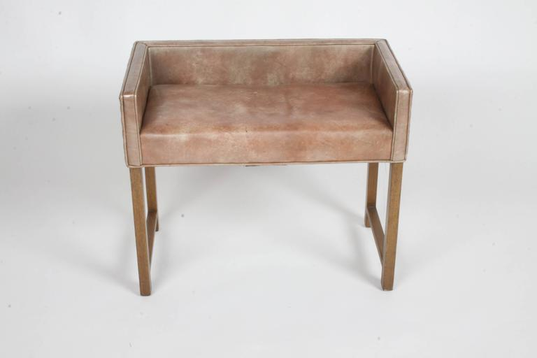 Early Edward for Dunbar Vanity Stool with original leather. Legs to be touched up prior to shipping and buyer may want to update upholstery.   Seat area : 13