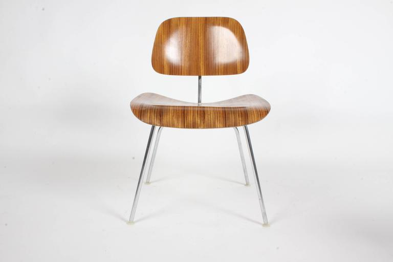 Pair of Charles Eames for Herman Miller zebrawood DCM chairs - rare set. Zebrawood was used from 1954-1959. Very nice original condition, minor scuffs. Labels.