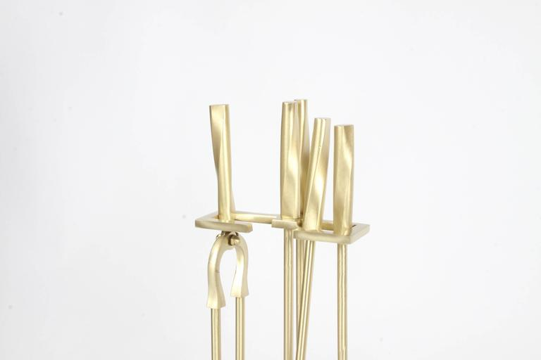 Mid-20th Century Brass Art Deco Modern torqued Andirons and Fire Tools Set, Deskey Style For Sale