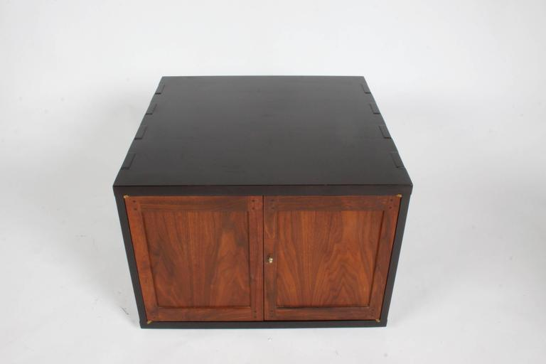 Edward Wormley for Dunbar Rare Janus cabinet, model 5811 This Janus collection piece is highly influenced by the Greene & Greene designed Arts and Crafts period furniture. Great details , pillowed finger joints, mortise and tenon joinery, solid