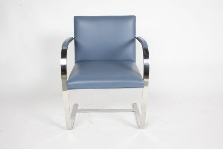 Pair of Mies van der Rohe flatbar Brno for Knoll in stainless steel with grey blue leather. In excellent condition marked with label. Only minor scuff to leather see photo. Production year 2000.