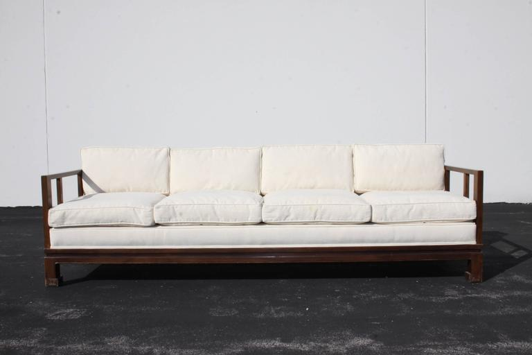 Michael Taylor designed sofa for the Baker Far East collection with down filled cushions. This sofa has been reupholstered at some point, has a few stains, as seen in photos, I would suggest re-upholstery if perfection is desired. I can proved a