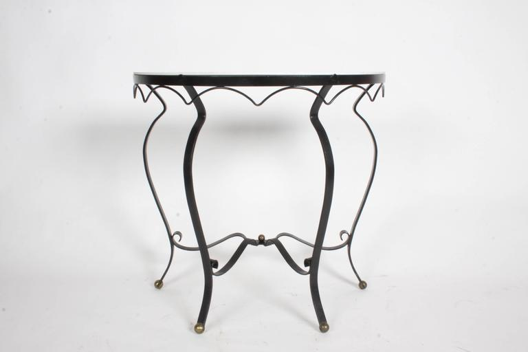 French Deco style wrought iron and vitrolite demilune console 1940s with brass ball details. Some loss of paint. No chips to vitrolite. Mid-Century Modern.