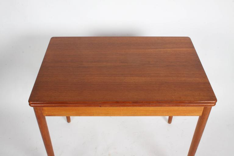 Danish flip-top table with pivot by Hans Wegner for Andreas Tuck of Denmark, circa 1950s. Can be used as a dining table, card table, console or desk. Branded Fabrikat: Andr Tuck, Arkitekt: Hans J. Wegner Made in Denmark. In very nice original