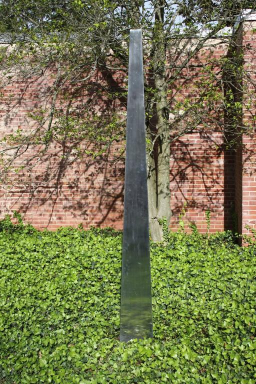 Large stainless steel triangular obelisk sculpture for the garden, courtyard or yard. This sculpture comes from a local estate of an owner of a local bank. I believe this was commissioned in the 1970s or early 80s for his yard, it is very well made!