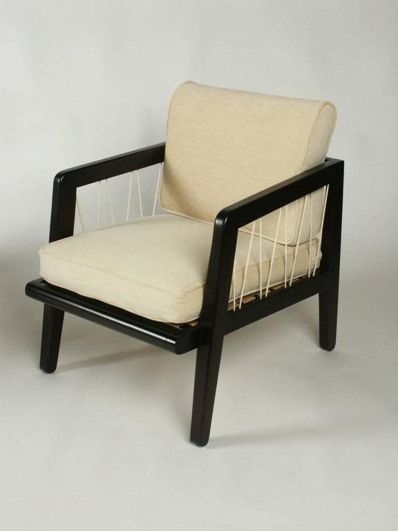 Pair of Edward Wormley Precedent collection for Drexel lounge chairs, circa 1947, dark stain on silver elm with woven nylon cording that zig zags between frame arm and seat. COM as this set shown is sold. This line was designed while designing for