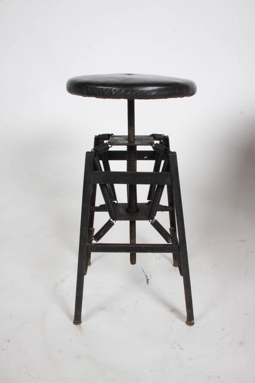 Charles E. Miller for American Cabinet Co. designed in the 1920s. This spring suspension had many uses for doctors, dentist, architects or artist. This design reminds me of the Eiffel Tower chair base design by Charles Eames for Herman Miller. This