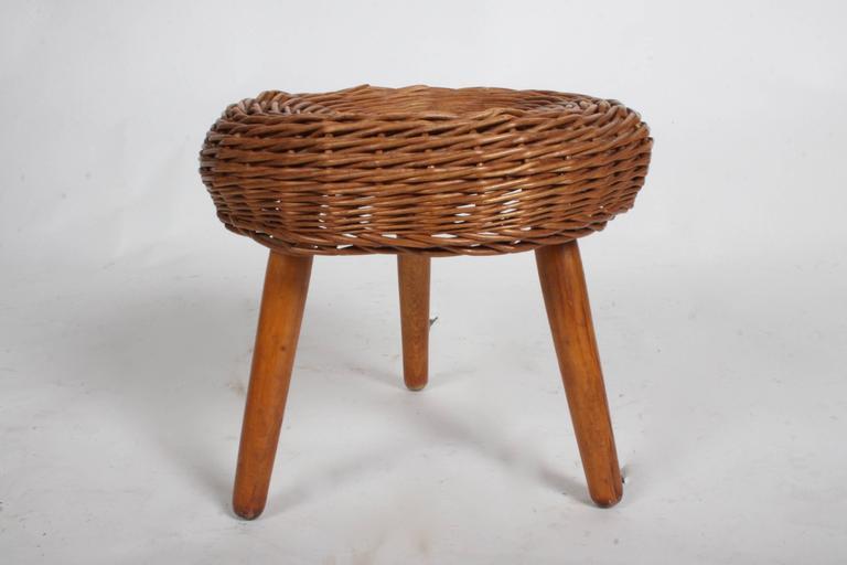 Tony Paul rattan stool on wood legs, circa 1950s.