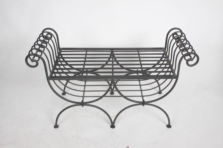 Mid-Century Italian black wrought iron double scroll arm bench with loose pink seat cushion and original black paint. Foam in seat is fine.