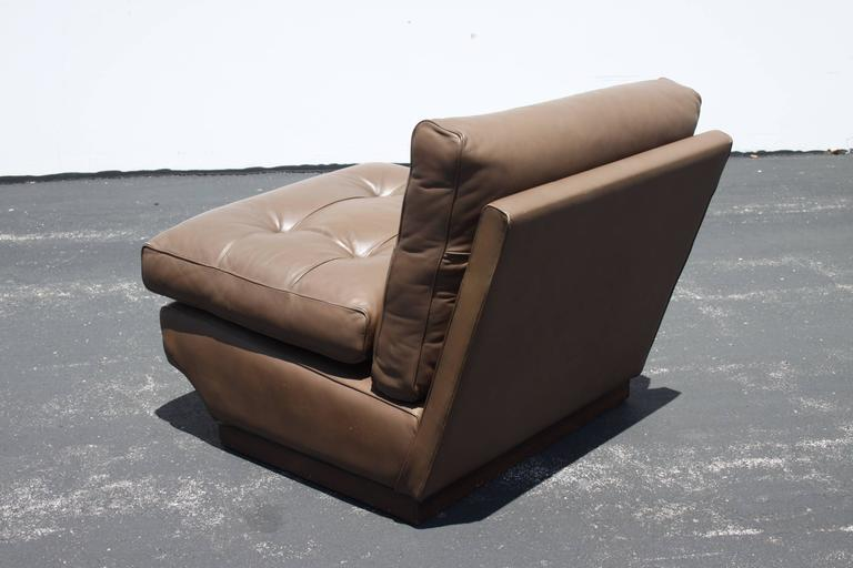 Pair of Mario Bellini brown leather tufted lounge chairs for B&B Italia on wood frames, designed in the 1960s. Imported by Atelier International, LTD. Leather has minor scuffs, overall very nice condition.