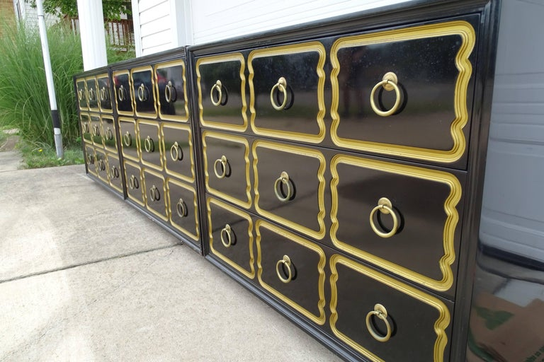 Original Dorothy Draper for Heritage, Bunching chests, circa 1955. Each chest has three drawers with brass ring hardware  and incised design highlighted in gold. They are finished on the backside which allows them to float in a room. The Espana