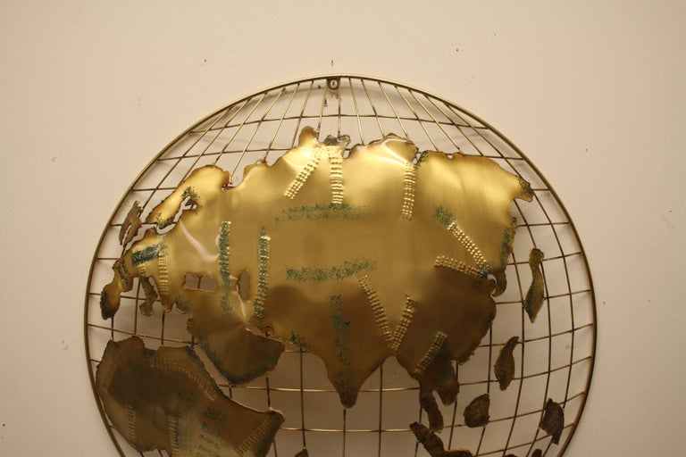 Curtis Jere brass globe sphere sculptures signed and dated 1984. Torched cut shapes with textured brass metal to create mountains , applied green paint and clear lacquer. Each sculpture is handmade, originally designed in the 1960s, this production