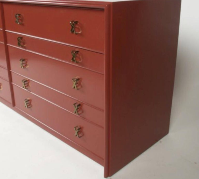 Paul Frankl for Johnson furniture Mid-Century dresser with ten drawers with brass X-pulls. Shown in Chinese red lacquer (customized lacquer color available or wood stain) highboy and pair of nightstands also available.    Currently being