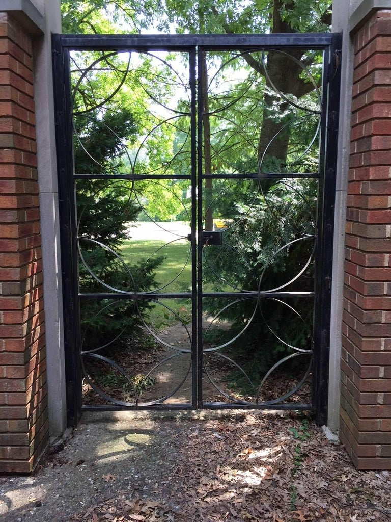 Custom garden gate designed by architect R.L. Fischer & Associates for the St. Matthews Episcopal Church in Warson Woods a suburb of St. Louis, circa 1959. Unfortunately this midcentury gem was recently demolished. This is a well made heavy duty