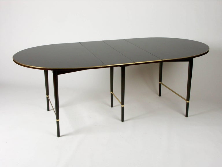 Paul McCobb oval mahogany dining table with brass inlay edge, Six 11