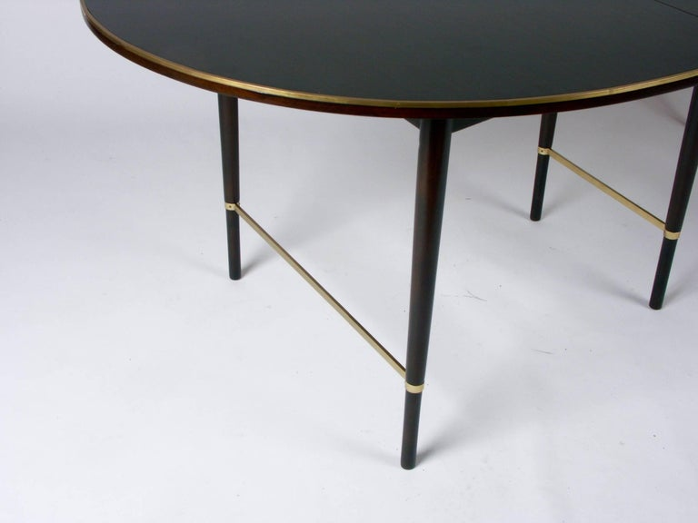 American Large Paul McCobb Oval Mahogany and Brass Dining Table with Six Leaves For Sale