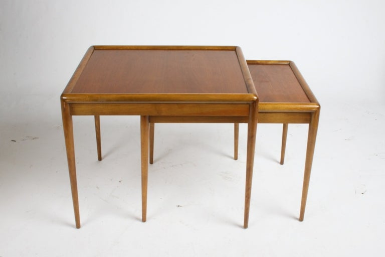 Nesting tables by Robsjohn-Gibbings for Widdicomb, two tables of walnut, currently being refinished.  Measure: Larger table 24