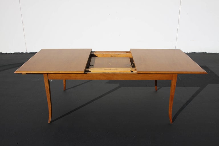 Mid-20th Century T.H. Robsjohn-Gibbings for Widdicomb Saber Leg Dining Table with Built in Leaves For Sale