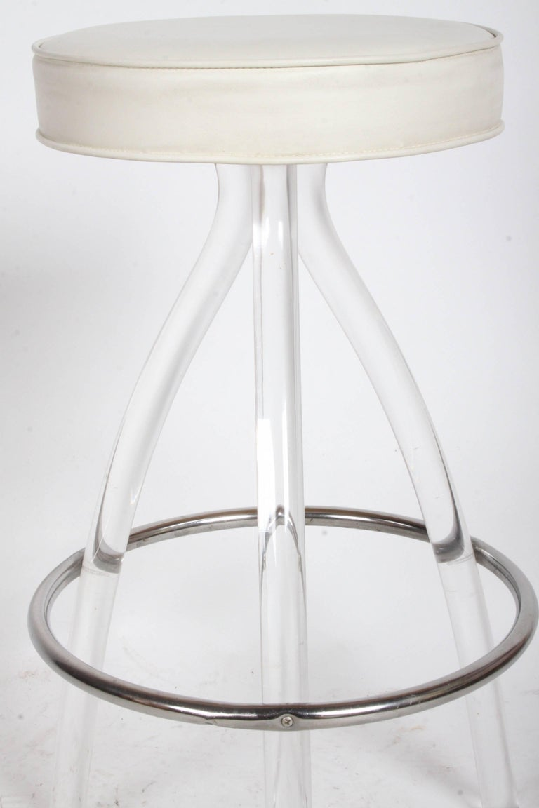 American set of three 1970s lucite bar stools for sale