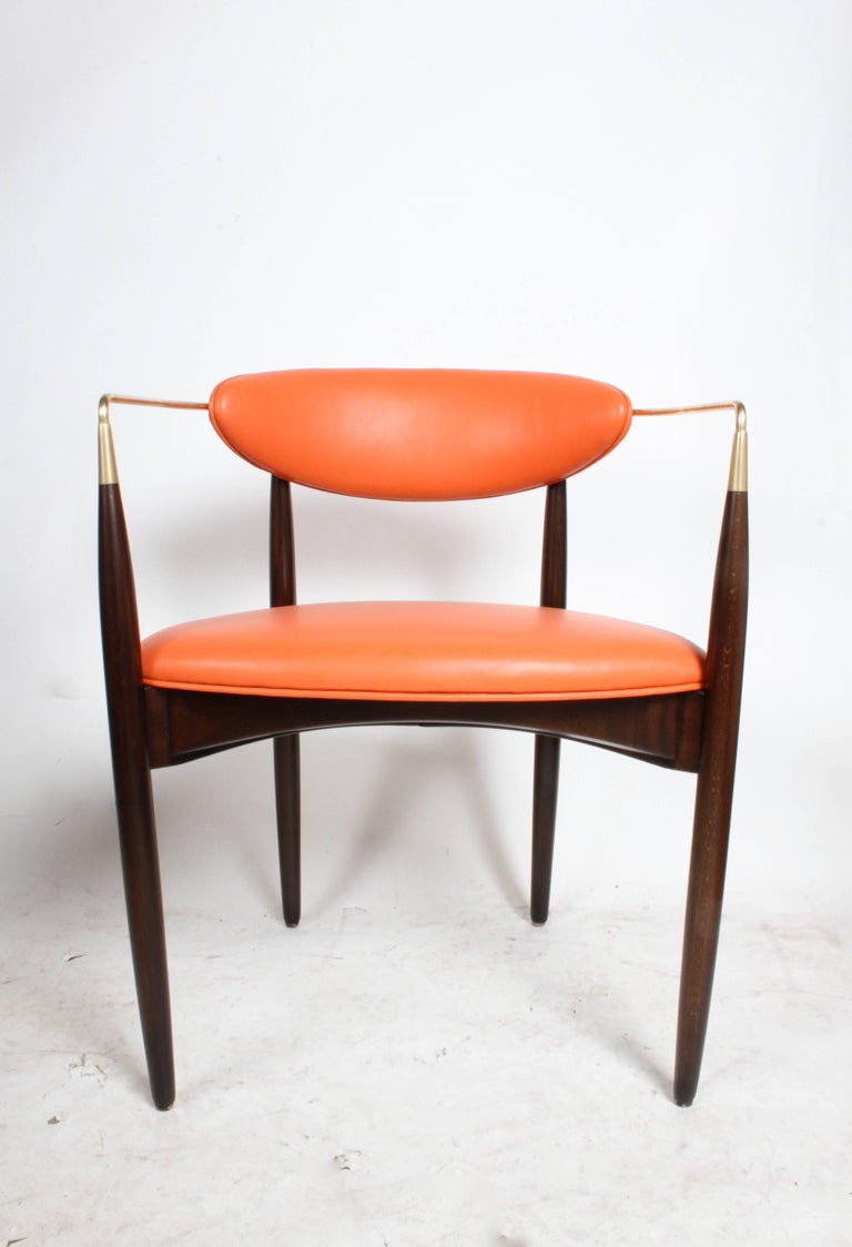 "Dan Johnson ""Viscount"" brass armchairs, circa 1950s. Refinished in dark stain with new foam, orange leather and polished brass. Arm height 26-3/8"" COM is available option on these chairs."