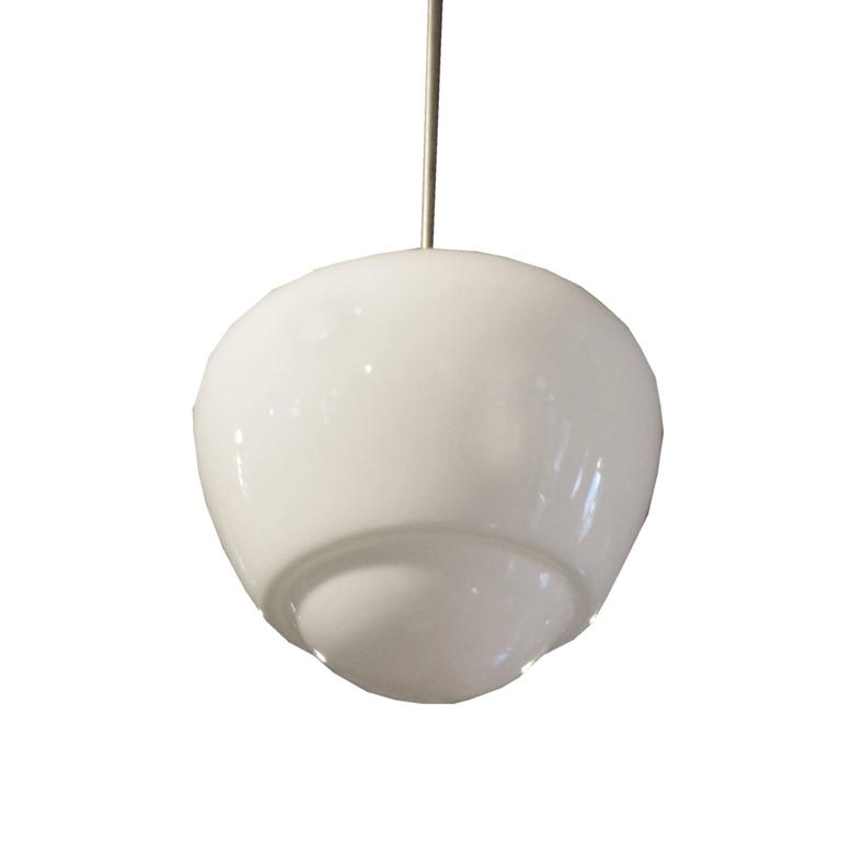 A fun Mid-Century light fixture from the Czech Republic with an opaque glass shade and brass down rod. Many available.