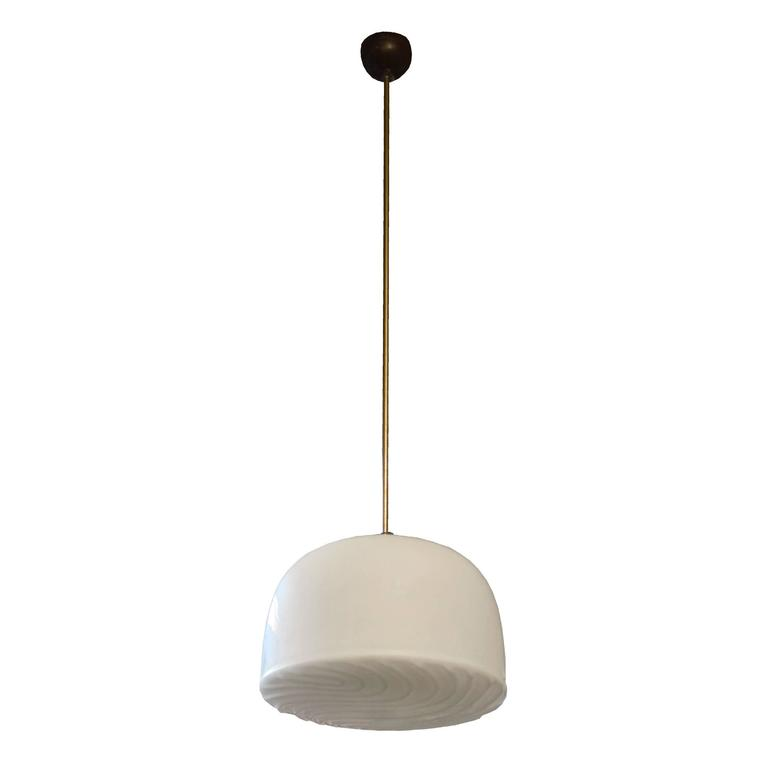 A Czech republic Mid-Century pendant light fixture with an opaque glass shade with a raised design. Four available.