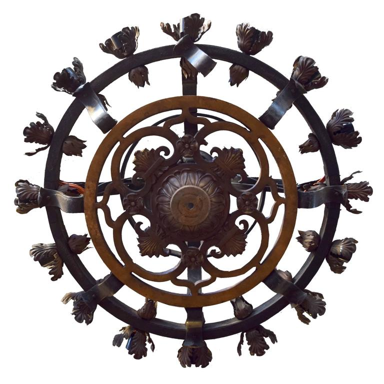 A great quality iron chandelier with sixteen lights with an acanthus leaf motif, circa 1900. Many available.