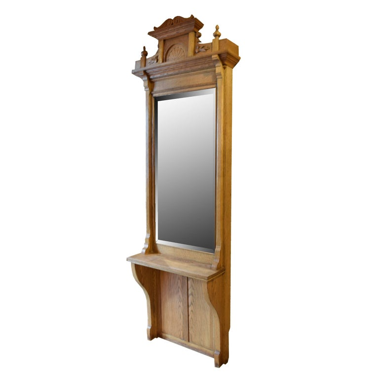 An American oak pier mirror with a shelf and a great pediment, 19th century.