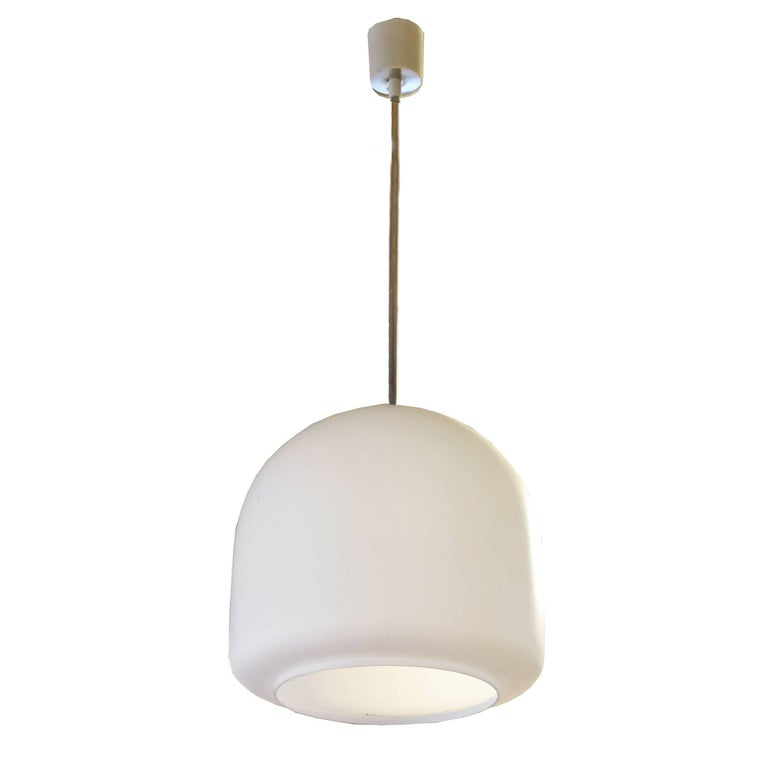 A fun Czech Republic Mid-Century pendant light fixture with an opaque glass shade. Many available.