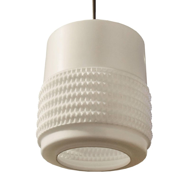A cool Mid-Century light fixture with a cylindrical opaque glass shade. Two available.