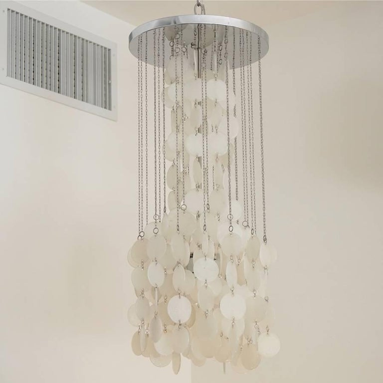 Mazzega cascade chandelier. White glass disks suspended on nickel chains. Two available. Priced individually.