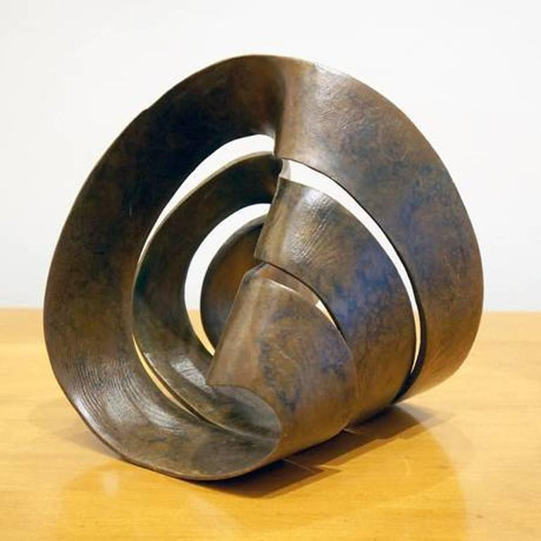 Bronze sculpture by Larry Frazier. Multi shaped possibilities ... a puzzle if you will.  I carved this piece originally in redwood – you can see the grain, captured in the bronze. My math teachers showed me what happens when you cut a mobius strip