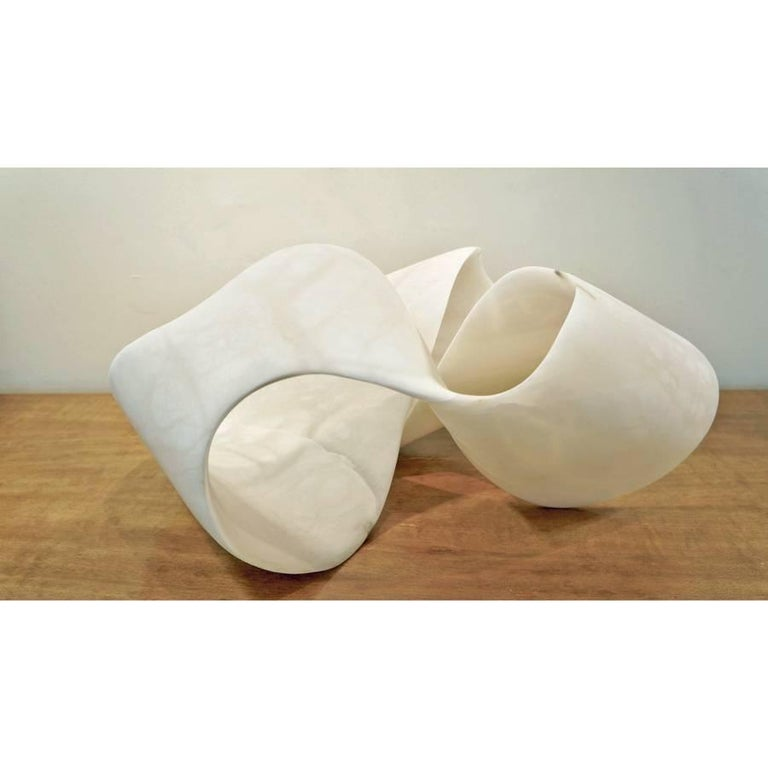 An extraordinary piece, based on a Mobius strip, which has one edge and one surface. The alabaster from Volterra, Tuscany, is stunning, both in scale and translucency. Carved from a single block of alabaster.