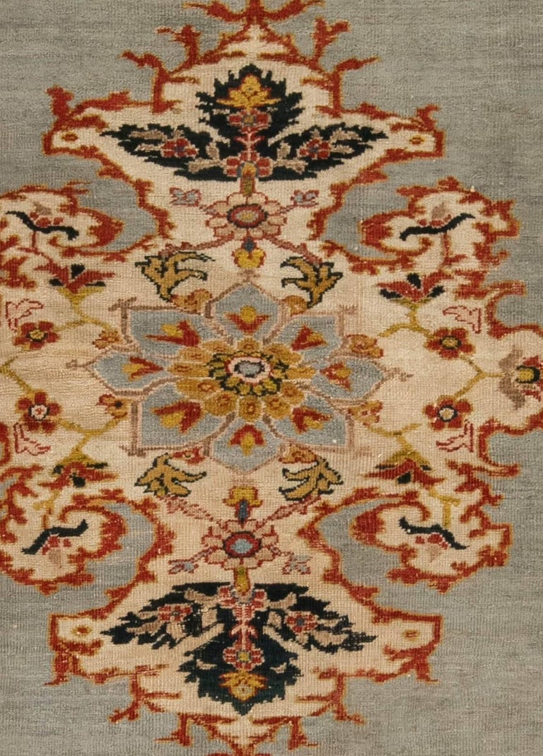 Antique Sultanabad rugs are among the most desirable Persian antique carpets to be produced in the late 19th and early 20th century. This very piece is a fine example of the exceptional Sultanabad craftsmanship from the dawn of the bygone era. What