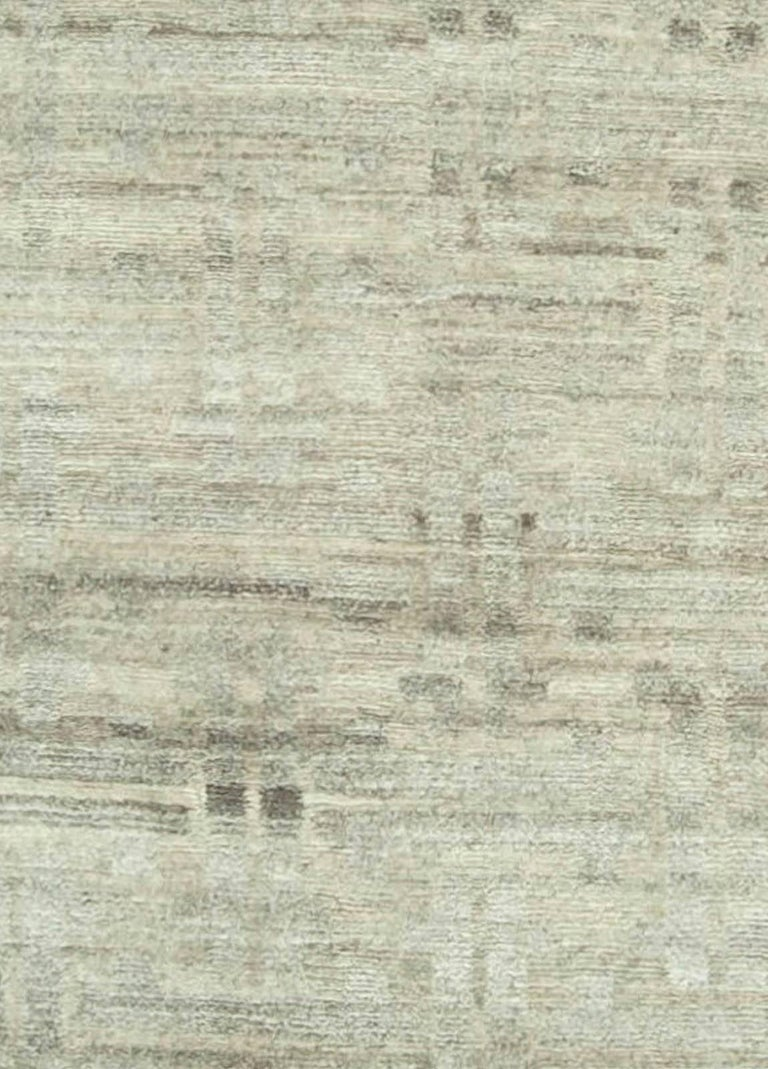 Hand-knotted wool rug.