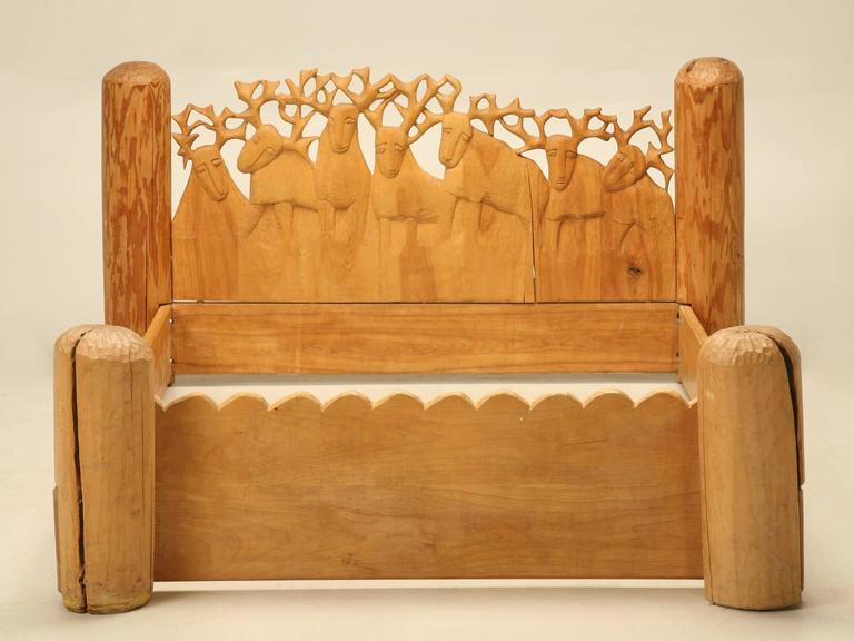 """Maybe one of my all-time favorite beds which was hard-carved by the noted sculptor Jerzy Kenar, about 30 years ago. We probably should have named it; """"Seven Stags"""" because there are seven stags carved to form the headboard. The bed takes a standard"""