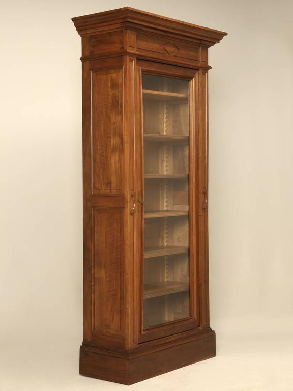 Unusually narrow for an antique French bookcase, or as they prefer to call it, a bibliotheque. Made from solid walnut around the turn of the century and was very well maintained and was actually so nice, that all we had to do was give it a thorough
